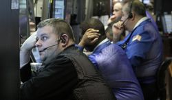 Traders work on Monday, Feb. 27, 2012, on the floor of the New York Stock Exchange. (Associated Press)