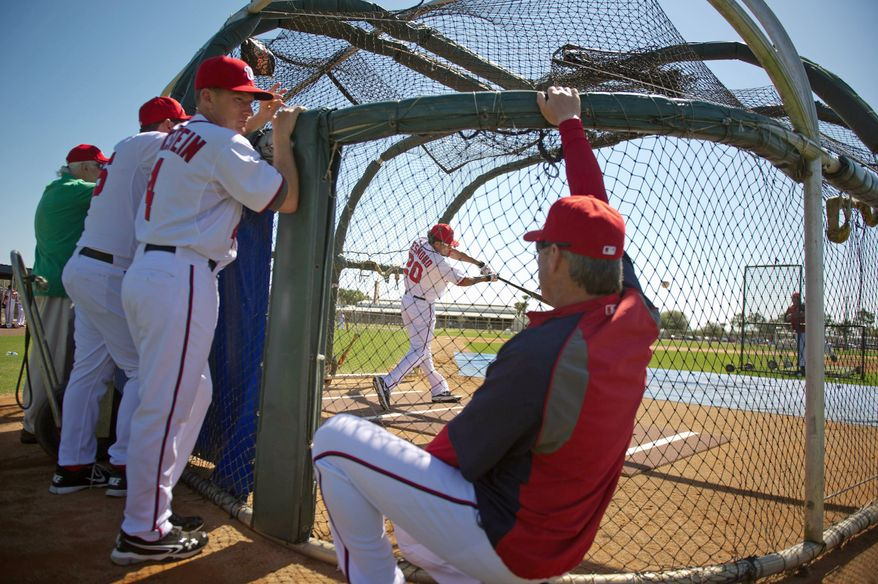 Nationals shortstop Ian Desmond shows off his stroke in the batting cage in Viera, Fla. His average improved over the last six weeks of the 2011 season when he was moved from No. 8 in the lineup to leadoff. (Andrew Harnik/The Washington Times)