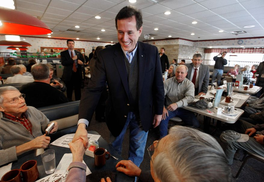 Republican presidential candidate Rick Santorum greets diners Tuesday at New Beginnings Restaurant in Kentwood, Mich. In an attempt to defeat Mitt Romney in the state, Mr. Santorum's campaign actively solicited votes from an unlikely source: registered Democrats in Michigan. The AFSCME union is helping him with ad buys in Ohio. (Associated Press)