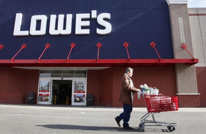 A customer leaves a Lowe's home-improvement store in New York on Tuesday, Feb. 21, 2011. (AP Photo/Mark Lennihan)