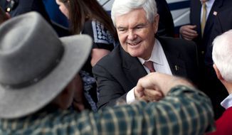 Republican presidential candidate, former House Speaker Newt Gingrich shakes hands during a campaign rally in Rome, Ga., Tuesday, Feb. 28, 2012. (AP Photo/Evan Vucci)