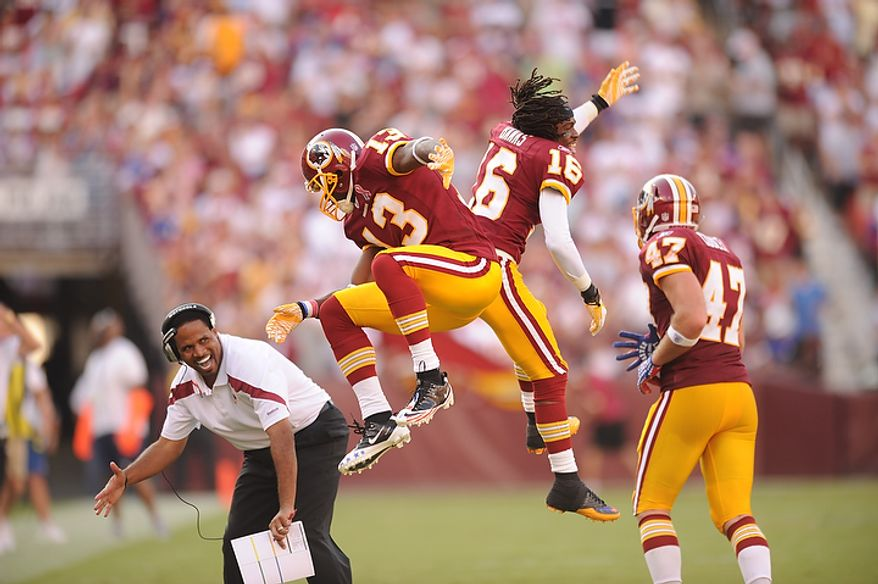 Washington Redskins WR Anthony Armstrong (13) celebrates his touchdown with WR Brandon Banks (16) in the second quarter against the New York Giants at FedEx Field in Landover, Md., on Sunday, Sept. 11, 2011. (Andrew Harnik/The Washington Times)