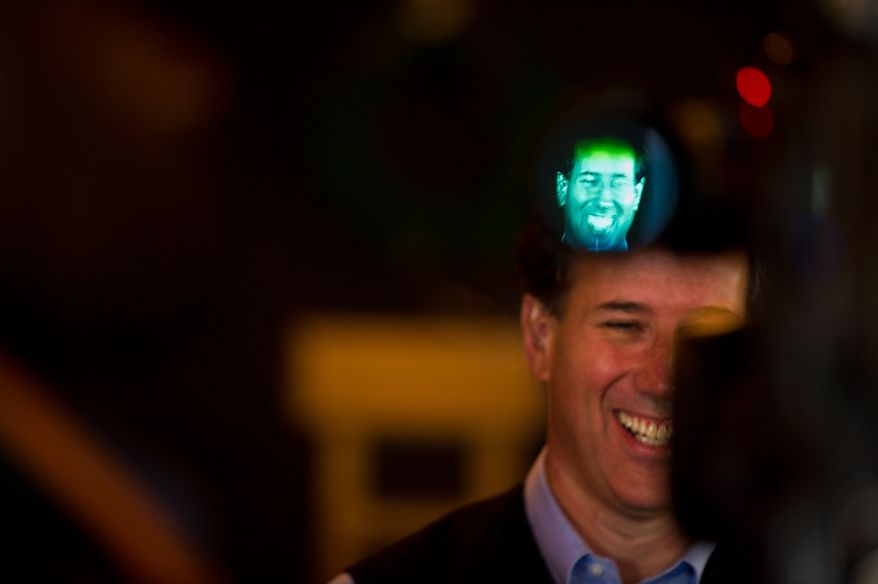 Republican presidential candidate Rick Santorum, a former Pennsylvania senator, is interviewed live on CNN following a town-hall meeting at the Button Factory Restaurant in Muscatine, Iowa, on Thursday, Dec. 29, 2011. (Andrew Harnik/The Washington Times)