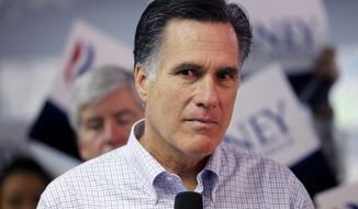 Republican presidential candidate, former Massachusetts Gov. Mitt Romney, listens to a question from a reporter as he visits a campaign call center in Livonia, Mich., Tuesday, Feb. 28, 2012. (AP Photo/Gerald Herbert)