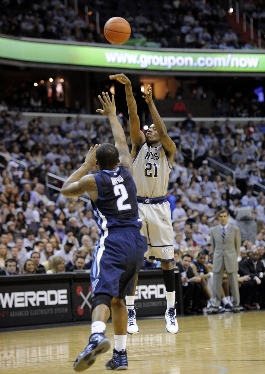 Georgetown guard Jason Clark takes a shot against Villanova guard Maalik Wayns during the second half  Saturday, Feb. 25, 2012, in Washington. Georgetown won 67-46. (AP Photo/Nick Wass)