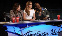 """American Idol"" judges (from left) Steven Tyler, Jennifer Lopez and Randy Jackson praised most of the male semifinalists during Tuesday's performances. (Fox via Associated Press)"