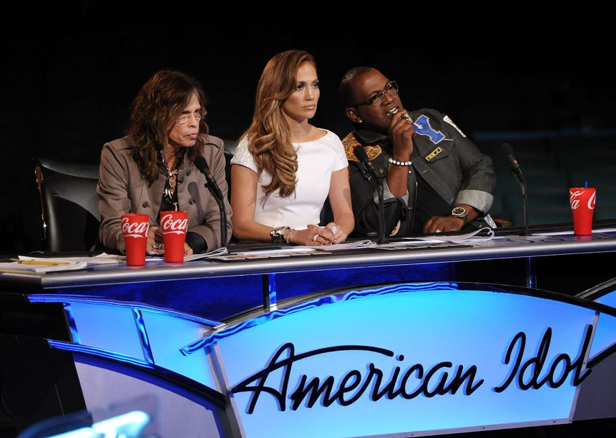 """""""American Idol"""" judges (from left) Steven Tyler, Jennifer Lopez and Randy Jackson praised most of the male semifinalists during Tuesday's performances. (Fox via Associated Press)"""