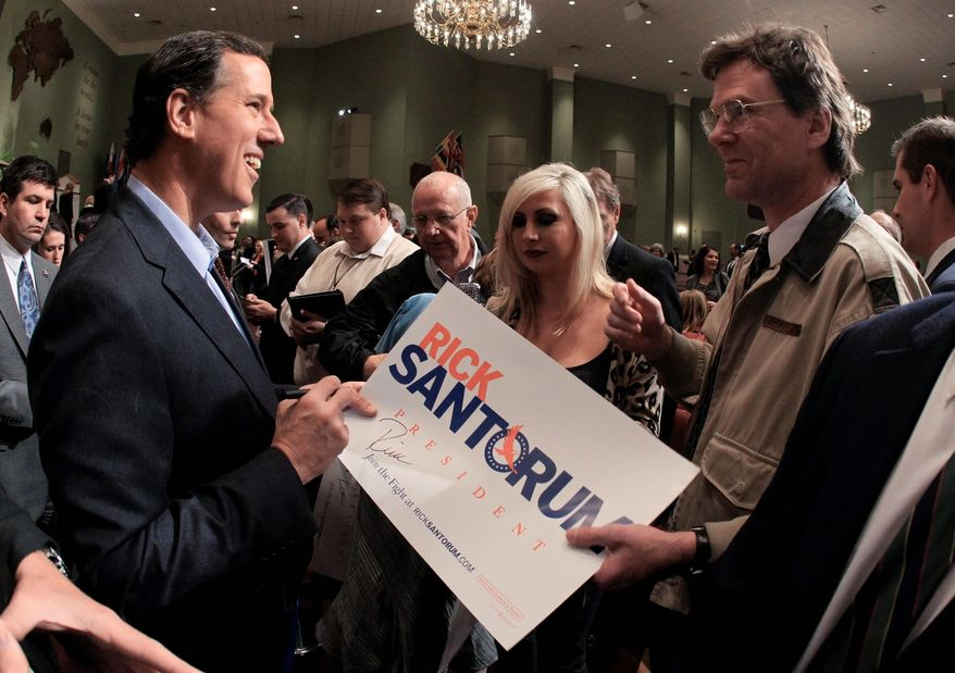 Former Sen. Rick Santorum of Pennsylvania, a Republican presidential candidate, greets supporters after speaking at Temple Baptist Church in Powell, Tenn., on Wednesday. Mr. Santorum won 15 delegates in the Michigan primary. (Associated Press)