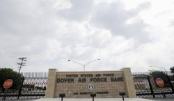 **FILE** This photo from Aug. 9, 2011, shows the closed gates at Dover Air Force Base, Del. (Associated Press)
