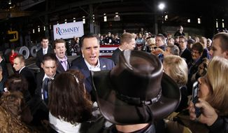 Republican presidential candidate and former Massachusetts Gov. Mitt Romney greets supporters Feb. 29, 2012, at American Posts in Toledo, Ohio. (Associated Press)