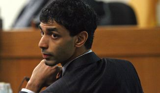 Dharun Ravi turns to look behind him Feb. 28, 2012, during his trial in New Brunswick, N.J. Ravi is accused of using a webcam to spy on his roommate, Tyler Clementi, during an intimate encounter with another man. Days later Clementi committed suicide. (Associated Press/The Courier-News)