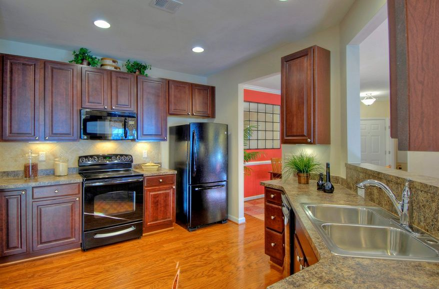 The kitchens at the Hampton Court condominiums at Legacy at Cherry Tree have 42-inch cabinets, a pantry and a breakfast bar.