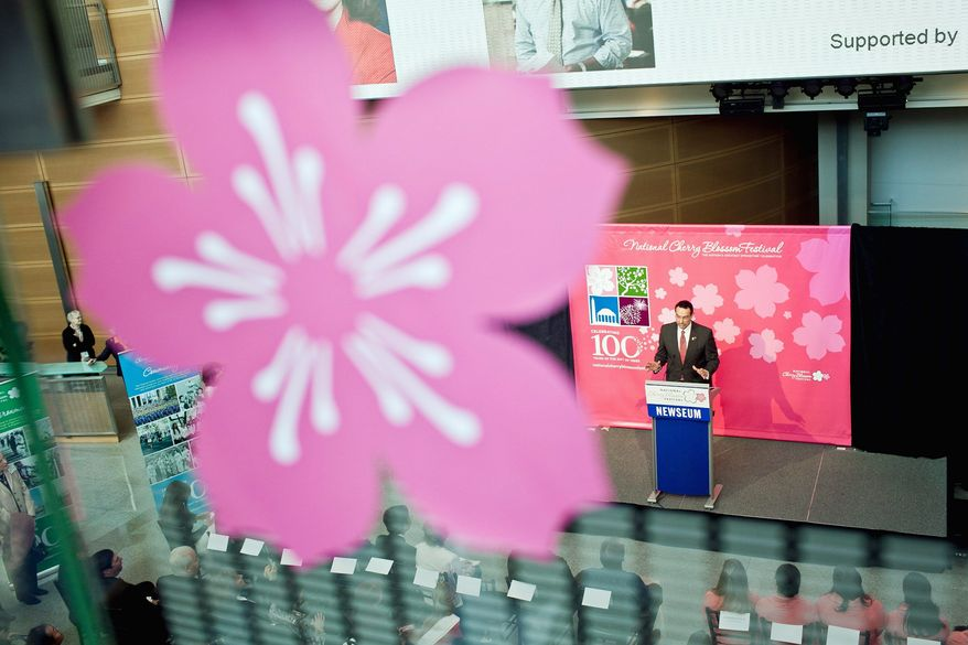 D.C. Mayor Vincent C. Gray speaks during a news conference at the Newseum to discuss plans for this year's National Cherry Blossom Festival.  (T.J. Kirkpatrick/Special to The Washington Times)