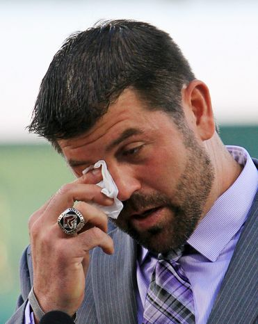 "Boston Red Sox catcher Jason Varitek wipes a tear while announcing his retirement Thursday in Fort Myers, Fla. The 39-year-old team captain says ""the hardest thing to do is walk away from your teammates"" after 15 seasons. (Associated Press)"