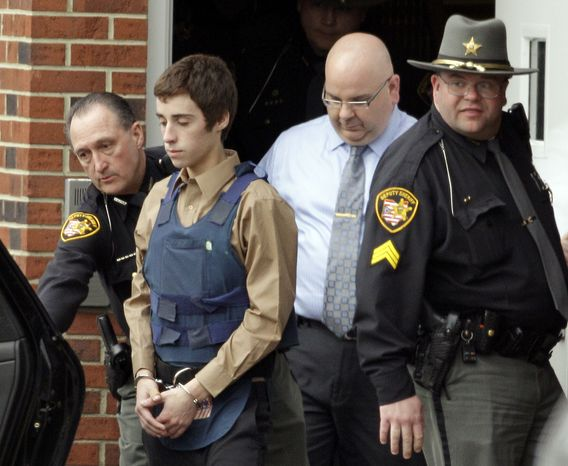 ** FILE ** Seventeen-year-old T.J. Lane is led from juvenile court by sheriff's deputies in Chardon, Ohio, on Tuesday, Feb. 28, 2012, after his arraignment in the shooting a day earlier of five high school students, three of whom died. (AP Photo/Mark Duncan)