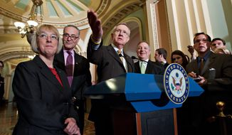 Senate Majority Leader Harry Reid (center), Nevada Democrat, leads a March 1, 2012, news conference with fellow Senate Democrats on Capitol Hill after the defeat of a Republican effort to roll back President's policy on contraception insurance coverage. He is joined by (from left) Sens. Patty Murray of Washington state, Charles Schumer of New York and Senate Majority Whip Richard Durbin of Illinois. (Associated Press)