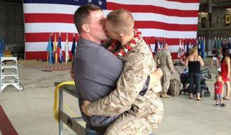 "Marine Corps Sgt. Brandon Morgan (right) greets his boyfriend with a passionate kiss at an on-base military-family homecoming. A friend photographed the embrace, which was posted on the ""Gay Marine"" Facebook page. (Courtesy of Facebook)"