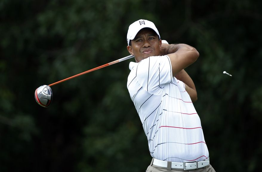 Tiger Woods tees of on the third hole during the first round of the Honda Classic golf tournament in Palm Beach Gardens, Fla., Thursday, March 1, 2012. (AP Photo/Lynne Sladky)