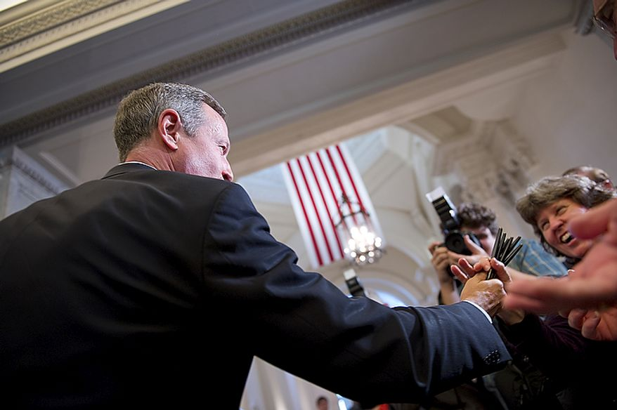 Maryland Gov. Martin O'Malley moves out to the crowd to hand out pens after signing the Civil Marriage Protection Act into law at the Maryland State House in Annapolis, Md., on Thursday, March 1, 2012. (Barbara L. Salisbury/The Washington Times)