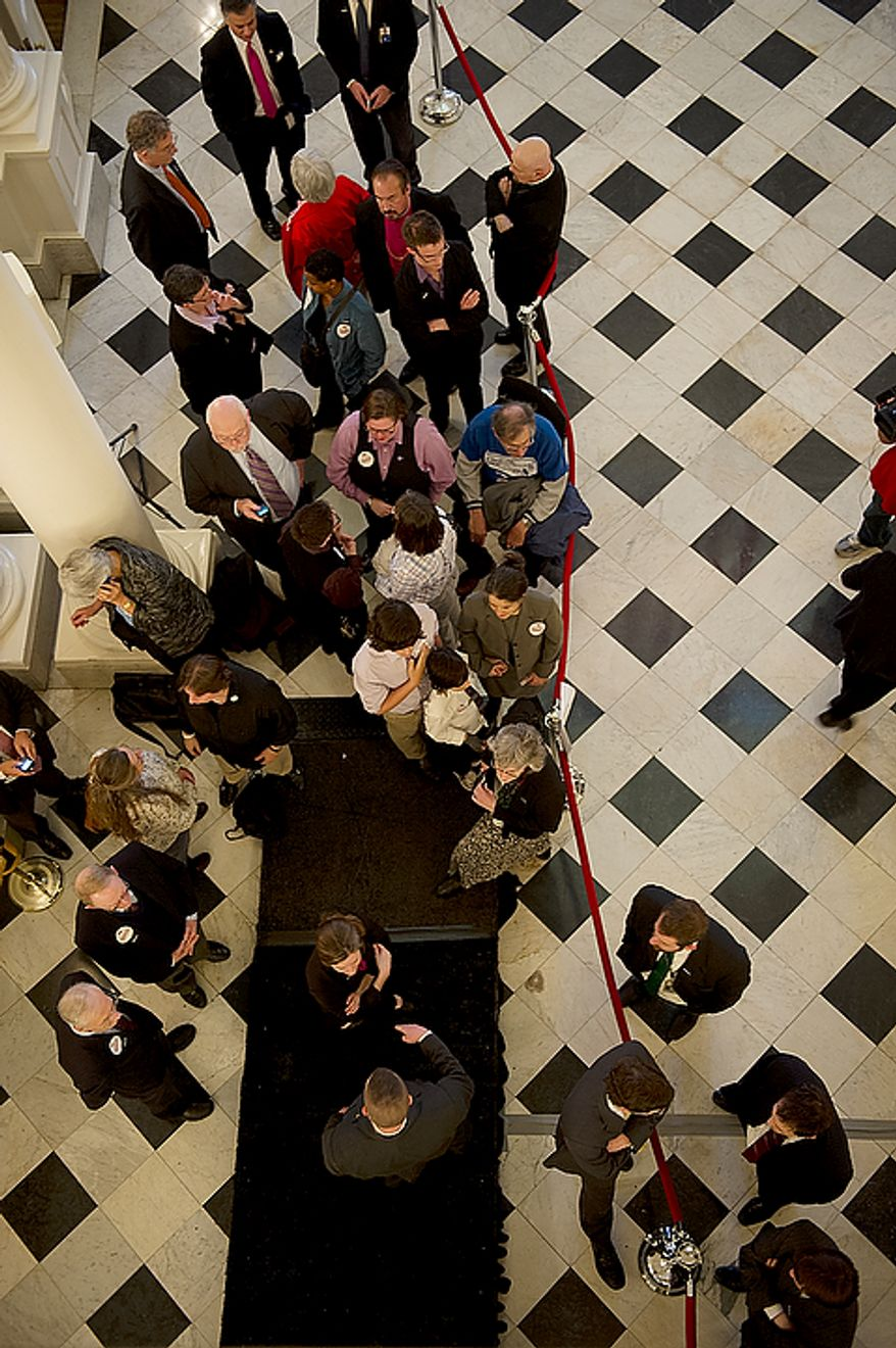 People line up to have their picture taken with Maryland Gov. Martin O'Malley, Senate President Mike Miller and Speaker of the House Michael Busch following the signing of the Civil Marriage Protection Act at the Maryland State House in Annapolis, Md., on Thursday, March 1, 2012. (Barbara L. Salisbury/The Washington Times)