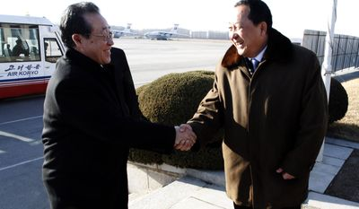 Kim Kye-gwan (left), North Korea's first vice foreign minister, is greeted by Ri Yong-ho, a vice minister in the North's Ministry of Foreign Affairs, at Pyongyang's airport on Monday, Feb. 27, 2012. Mr. Ri, who is in charge of the North's nuclear negotiations, is heading to the United States next week on the heels of a breakthrough nuclear agreement with the U.S. (AP Photo)