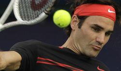 Roger Federer of Switzerland returns the ball during a quarterfinal of the Emirates Dubai ATP Tennis Championships against Mikhail Youzhny of Russia in Dubai, United Arab Emirates, Thursday, March 1, 2012. (AP Photo/Hassan Ammar)