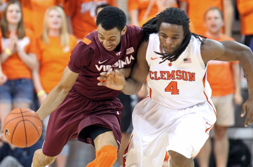 Virginia Tech's Dorian Finney-Smith runs up against Clemson's Rod Hall during the first half on Thursday, March 1, 2012 in Clemson, S.C. (AP Photo/Anderson Independent-Mail, Mark Crammer)