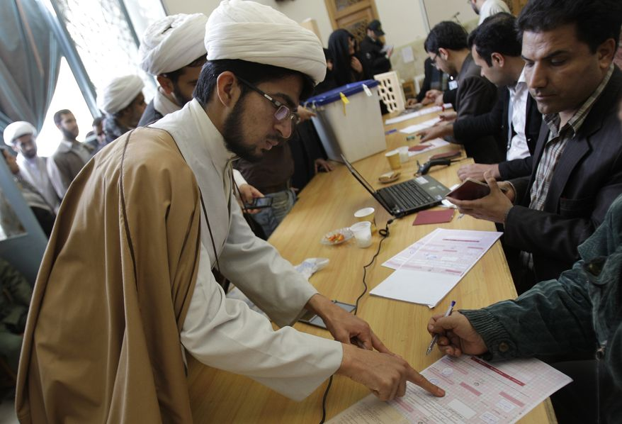 An Iranian fingerprints his ballot for the parliamentary elections on March 2, 2012, at Masoumeh shrine in the city of Qom, 78 miles (125 kilometers) south of Tehran. The balloting for the 290-member parliament is the first major voting since the disputed re-election of President Mahmoud Ahmadinejad in June 2009 and the mass protests and crackdowns that followed. (Associated Press)