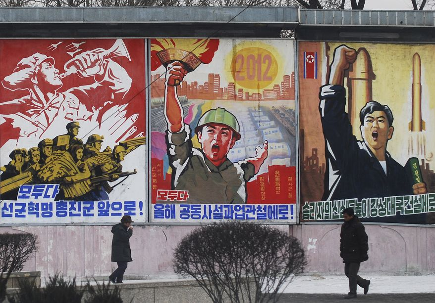 "**FILE** Residents walk Feb. 11, 2012, on a street in Pyongyang, North Korea, past posters with popular slogans illustrating North Korea's main policies. From left to right, they read, ""Let's march toward a military first revolution,"" ""Let's accomplish the tasks laid out in this year's joint new year's editorial,"" and ""Devote the victors' hearts to the building of a strong nation."" (Associated Press)"