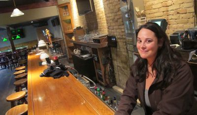 This photo taken Thursday, March 1, 2012, shows Sara Drescher, manager at 5th Ward Pub in the Walker's Point neighborhood in Milwaukee, where a marketing company is organizing a walking tour of bars where serial killer Jeffrey Dahmer hunted his victims. (AP Photo/Carrie Antlfinger)