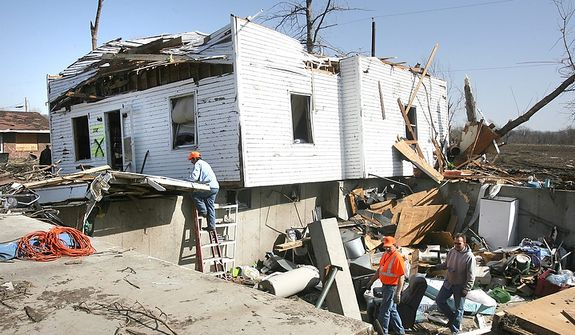 Residents assist in the cleanup after a tornado touched down, Thursday, March 1, 2012 in Harveyville, Kan.   (AP Photo/Topeka Capital-Journal, Thad Allton)