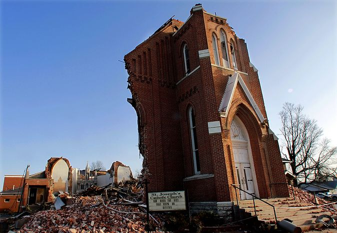St. Joseph's Catholic Church is seen left in ruins Thursday, March 1, 2012, in Ridgway, Ill. A pre-dawn twister flattened entire blocks of homes  Wednesday as violent storms ravaged the Midwest and South.   (AP Photo/Seth Perlman)
