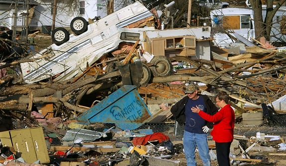 People try to salvage what they can after a tornado destroyed homes in their neighborhood Wednesday, Feb. 29, 2012, in Harrisburg, Ill. The tornado that blasted Harrisburg, killing six, was an EF4, the second-highest rating given to twisters based on damage. Scientists said it was 200 yards wide with winds up to 170 mph. (AP Photo/Seth Perlman)