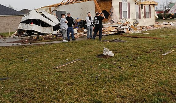 A stop sign lays over in the KC Estates subdivision after severe weather passed Hodgenville, Ky. on Wednesday Feb. 29, 2012.  Waves of strong storms ripped roofs off homes, apartment buildings and a bank and destroyed several buildings in north-central Kentucky. (AP Photo/Patti Longmire)