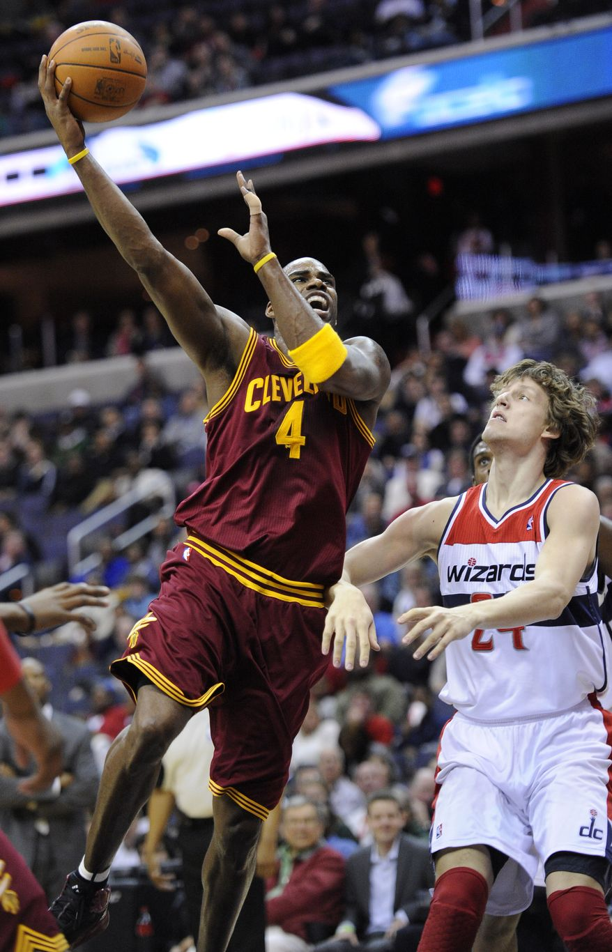 Cleveland Cavaliers forward Antawn Jamison goes to the basket against Washington Wizards forward Jan Vesely during the first half Saturday, March 3, 2012, in Washington. (AP Photo/Nick Wass)