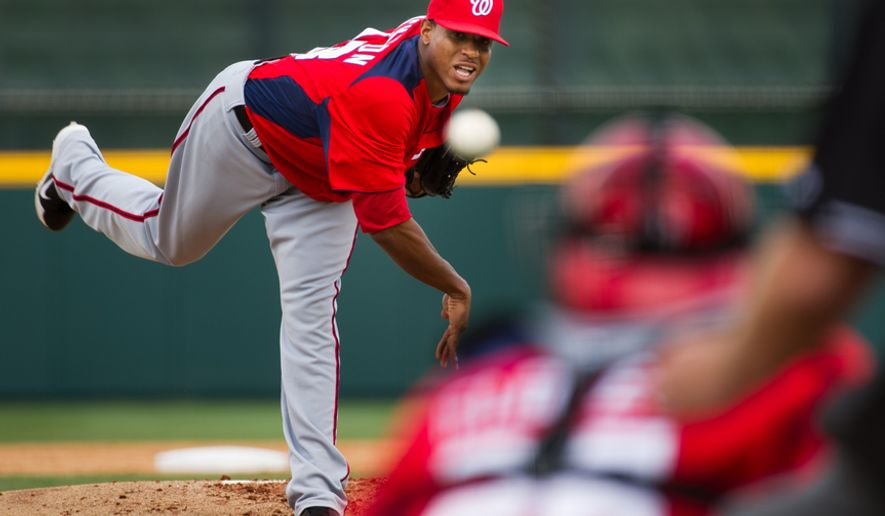 Washington Nationals pitcher Edwin Jackson (33) pitches in the first inning as the Washington Nationals play the Houston Astros during spring training at the Osceola County Stadium, Kissimmee, Fla., Saturday, March 3, 2012. (Andrew Harnik/The Washington Times)