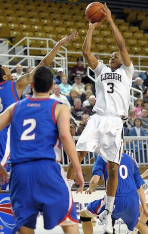 Lehigh guard C.J. McCollum shoots over American defenders during the semifinals of the Patriot League tournament Saturday, March 3, 2012, in Bethlehem, Pa. (AP Photo/The Express-Times, Matt Smith)