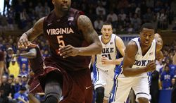 Virginia Tech's Dorenzo Hudson chases the ball against Duke's Miles Plumlee and Tyler Thornton during the second half in Durham, N.C., Saturday, Feb. 25, 2012. Duke won 70-65 in overtime. (AP Photo/Gerry Broome)