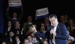 Republican presidential candidate Mitt Romney rallies supporters Sunday in Knoxville, Tenn. He and Rick Santorum head into Super Tuesday tied in The Washington Times/JZ Analytics' poll of Republican primary voters nationwide. (Associated Press)