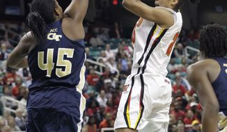 Maryland's Alyssa Thomas, right, shoots over Georgia Tech's Sasha Goodlett, left, during the first half of the ACC women's basketball tournament championship game in Greensboro, N.C., Sunday, March 4, 2012. (AP Photo/Chuck Burton)
