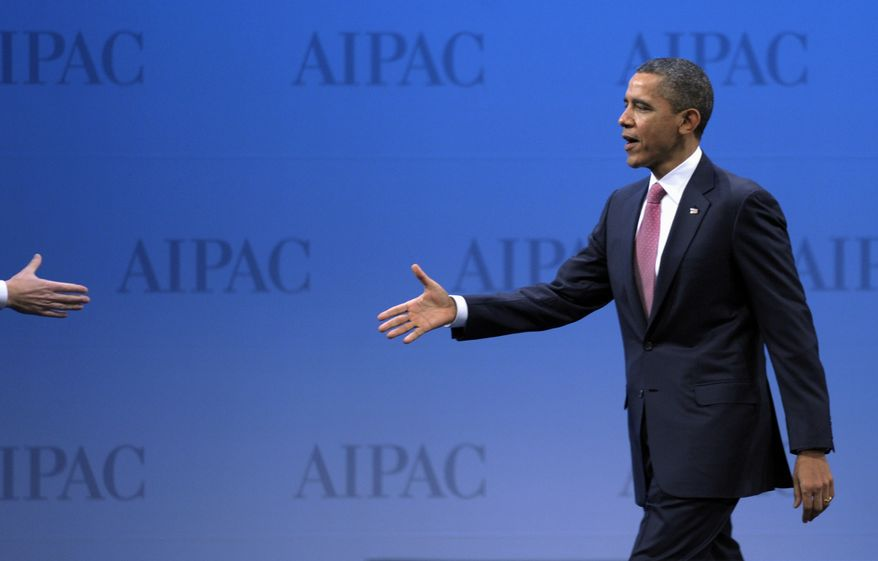 President Obama prepares to shake hands as he walks onstage to address the American Israel Public Affairs Committee (AIPAC) Policy Conference's opening plenary session in Washington on Sunday, March 4, 2012. (AP Photo/Cliff Owen)