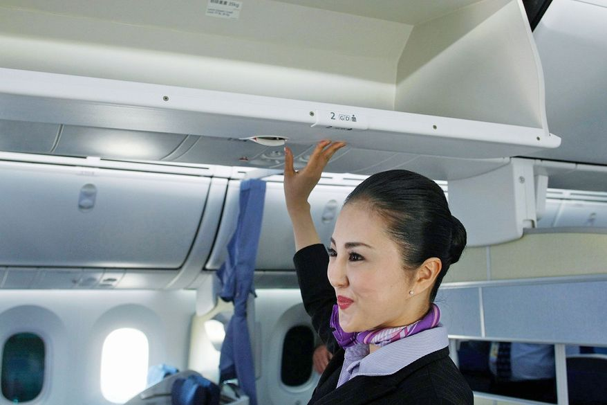 United and Delta have become the latest airlines to replace or upgrade overhead bins so they hold more luggage. The percentage of passengers bringing bags on planes has hovered around 87 percent in recent years. (Associated Press)