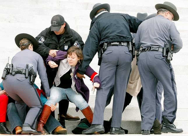 Virginia Capitol Police arrest more than 30 pro-choice activists when they refused to disperse as ordered. (Associated Press)