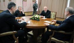 Russian Prime Minister Vladimir Putin (second from right) confers Monday in Moscow with three of the rivals he defeated in the presidential election a day earlier: Mikhail Prokhorov (left), Vladimir Zhirinovsky (second from left) and Sergei Mironov. (Associated Press)