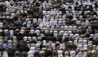 Protesters attend prayers in Sanaa, Yemen, on Friday, March 2, 2012, during a rally demanding the trial of former Yemeni President Ali Abdullah Saleh. (AP Photo/Hani Mohammed)