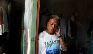 Evie, also known as Turdi, the former nanny of President Obama, stands Jan. 27, 2012, at the doorway of her room at a boarding house in a slum in Jakarta, Indonesia. Evie, who was born a man but believes she is really a woman, has endured a lifetime of taunts and beatings because of her identity. (Associated Press)