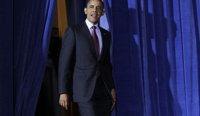 President Obama walks out to deliver remarks at a March, 2, 2012, conservation event at the U.S. Department of Interior in Washington. (Associated Press)