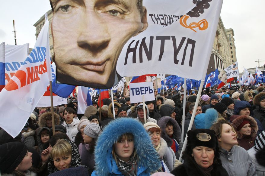 Supporters of Russian Prime Minister Vladimir Putin rally March 5, 2012, at the central Manezhnaya Square just outside the Kremlin in Moscow to celebrate Putin's victory in the presidential election. (Associated Press)