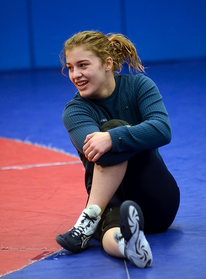 Helen Maroulis, a wrestler from Rockville, Md, may be the best U.S. wrestler in her weight class.  She is currently training  at the U.S. Olympic Training Center in Colorado Springs, Colo.   She and other members of the U.S. team, as well as wrestlers from other countries, spent time training together, Thursday,Mar. 1, 2012.  She stretches before the start of a light workout.   (BryanOller/Special to the Washington Times)