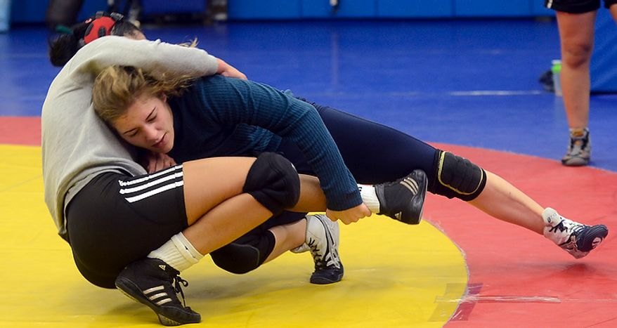 Helen Maroulis, a wrestler from Rockville, Md, may be the best U.S. wrestler in her weight class.  She is currently training  at the U.S. Olympic Training Center in Colorado Springs, Colo.   She and other members of the U.S. team, as well as wrestlers from other countries, spent time training together, Thursday,Mar. 1, 2012.  Maroulis and Venezuelan wrestler Marcia Andrades practice a two-arms one leg professional wrestling move. (BryanOller/Special to the Washington Times)